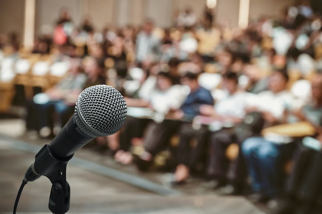 Microphone over the abstract blurred photo of conference hall Premium Photo
