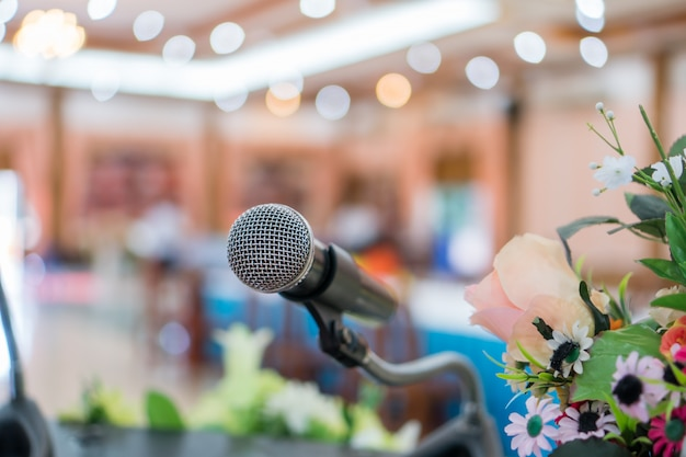 Microphone on abstract blurred of speech in seminar room or speaking conference hall light on stage Premium Photo