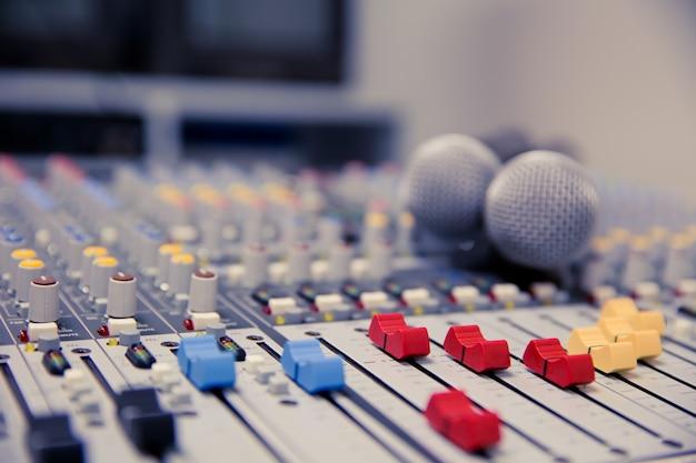 Microphone and audio mixer in studio. Premium Photo