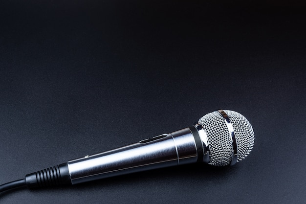 Microphone on a black background Premium Photo
