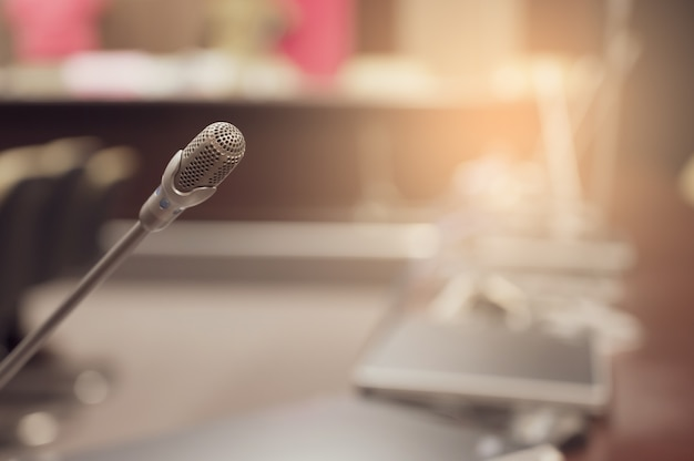Microphone over the blurred business forum meeting Premium Photo
