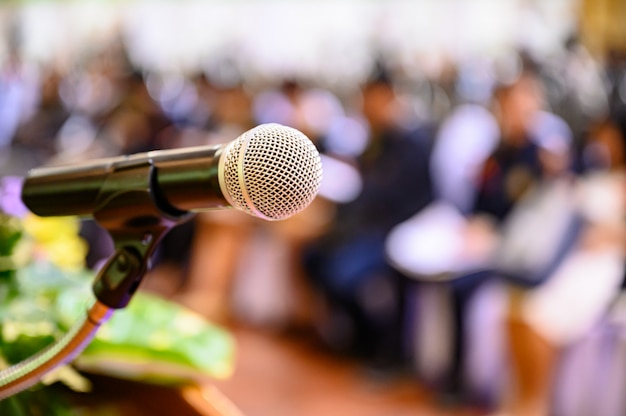 Microphone over the blurred business forum Premium Photo