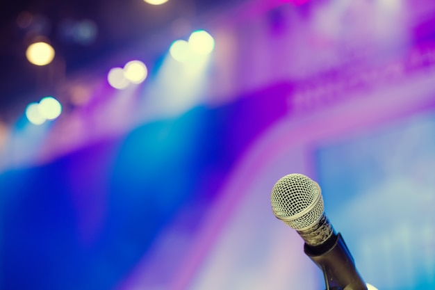 Microphone in the  conference hall or seminar room background. Premium Photo