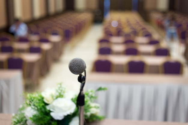 Microphone in the  conference hall or seminar room background Premium Photo