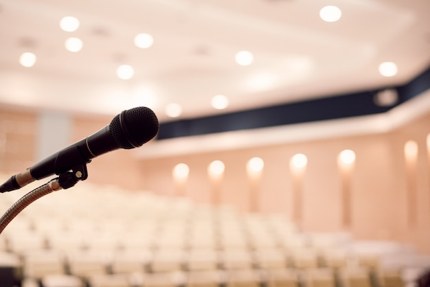 Microphone is located on the podium in a conference room. large meeting or seminar room Premium Photo