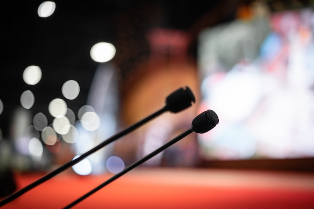 Microphone in meeting room for a party hall or conference room. Premium Photo