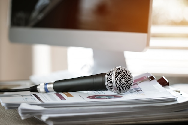 Microphone on paper document at seminar for speaker or lecture teacher at classroom university Premium Photo