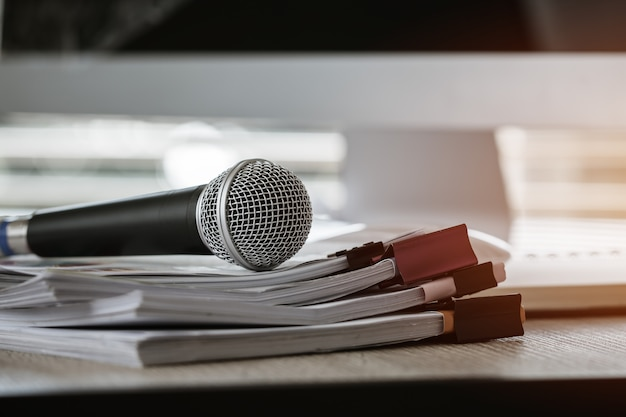Microphone on paper document at seminar for speaker or lecture teacher Premium Photo