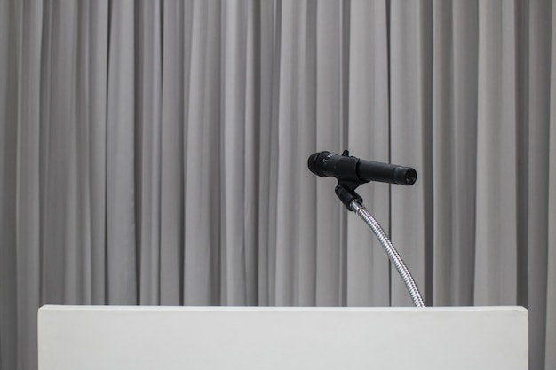 Microphone placed on the table in the meeting room with copy space Premium Photo
