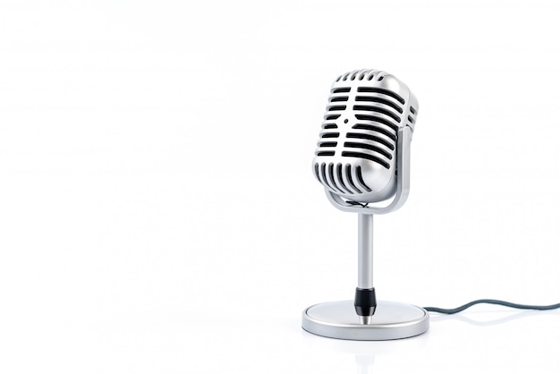 Microphone retro isolated on white wall. Premium Photo