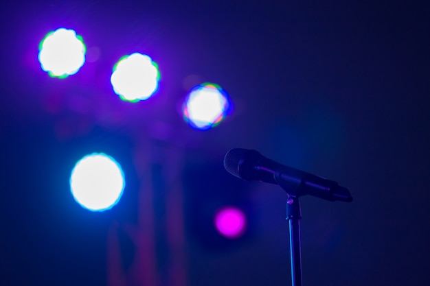 Microphone on stage against a background Premium Photo