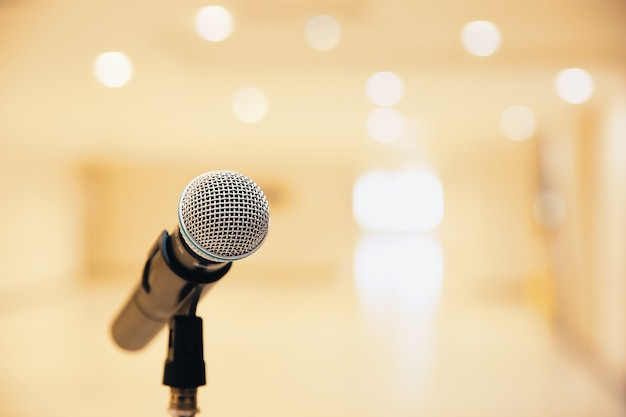 Microphone on the stand for public speaking. Premium Photo