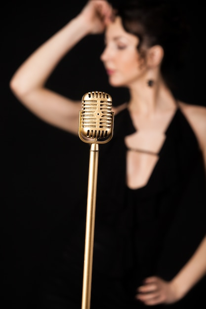Microphone with blur woman Free Photo