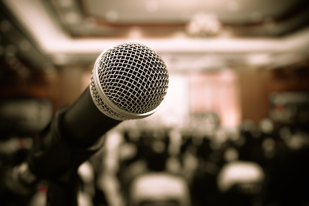 Microphones on abstract blurred of speech in meeting room, front speaking blur people Premium Photo
