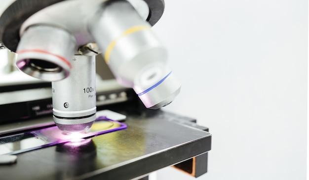 Microscope for checking slide in laboratory for medical technician Premium Photo