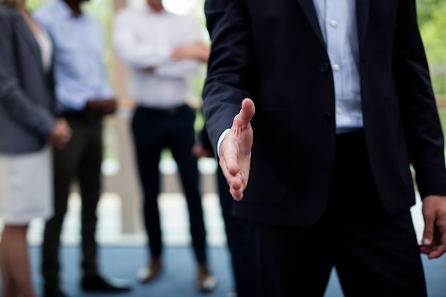 Mid section of business executives shaking hands Premium Photo