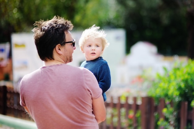 Middle age father with his little son walking outdoors. Premium Photo