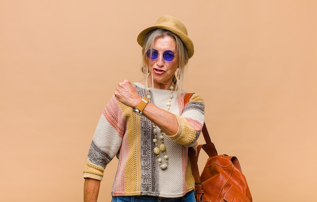 Middle age woman feeling happy, positive and successful, motivated when facing a challenge or celebrating good results Premium Photo