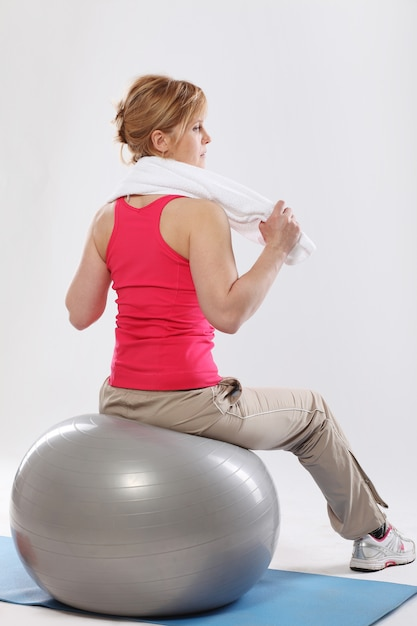 Middle age woman working out with grey ball Free Photo