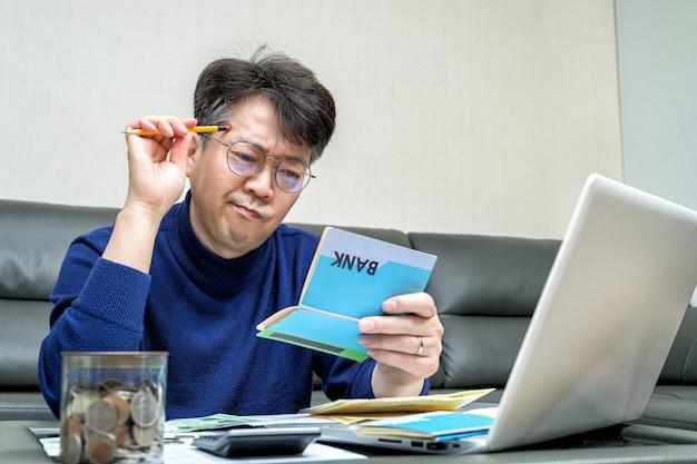Middle-aged asian man preparing for tax return. Premium Photo