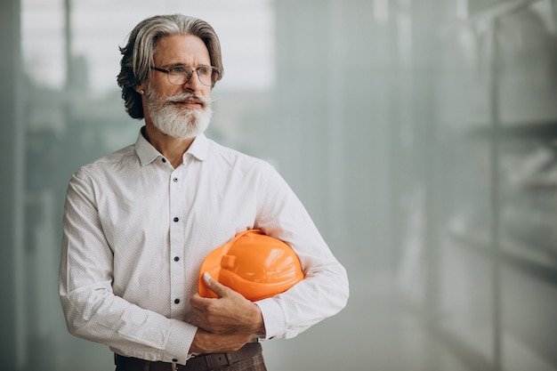 Middle aged business man in a hard hat Free Photo