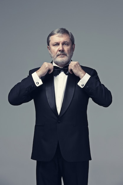 Middle aged male adult wearing a suit Free Photo