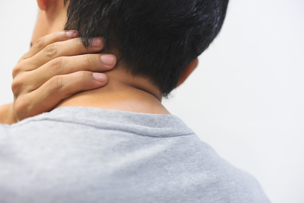 Middle aged man has neck pain. with copy space for text Premium Photo