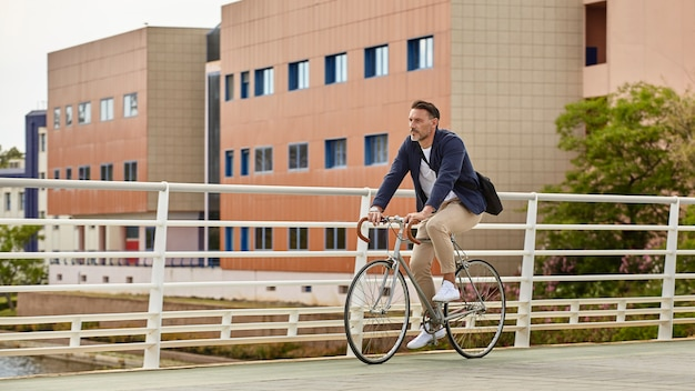 A middle aged man riding a bike Free Photo