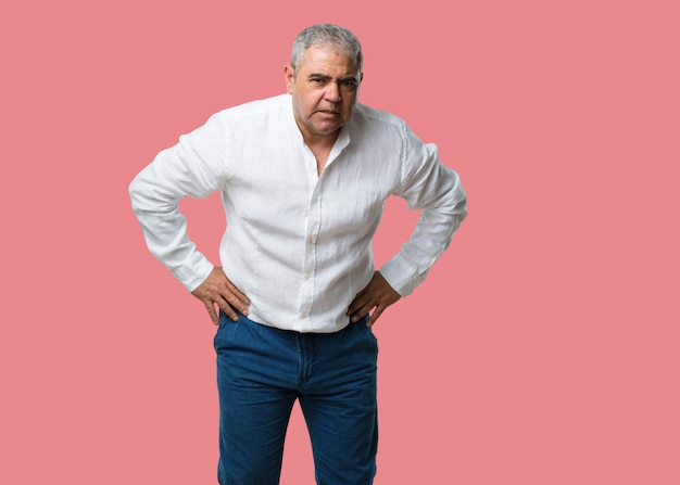 Middle aged man very angry and upset, very tense, screaming furious, negative and crazy Premium Photo
