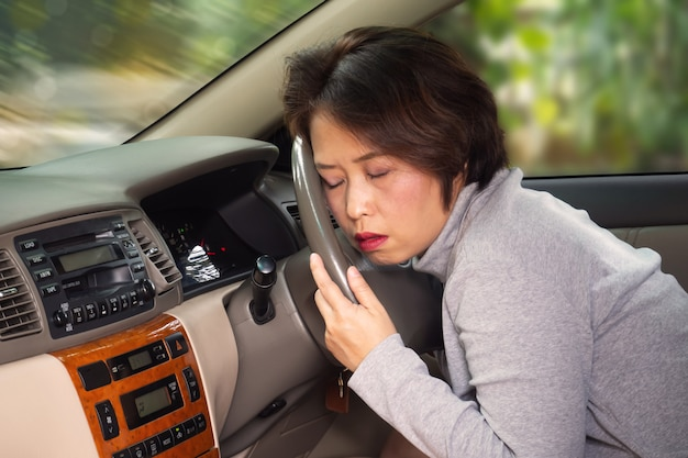 Middle asian adult sleepy behind steering wheel. risk in transport accident. Premium Photo