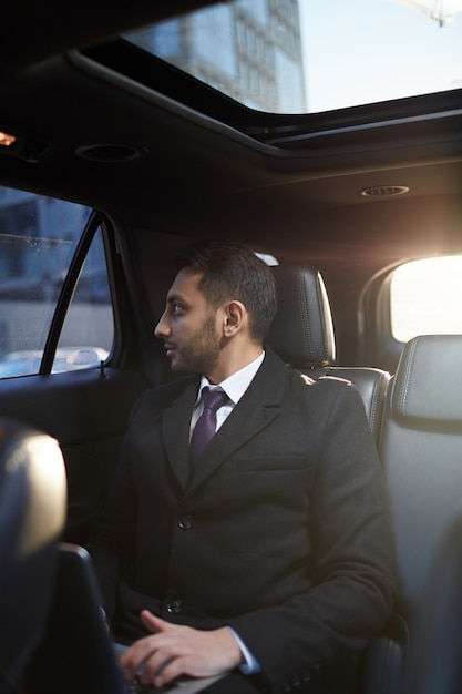 Middle-eastern businessman in expensive car Premium Photo