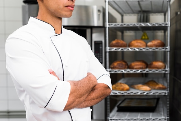 Midsection of a male baker with his arms crossed Free Photo