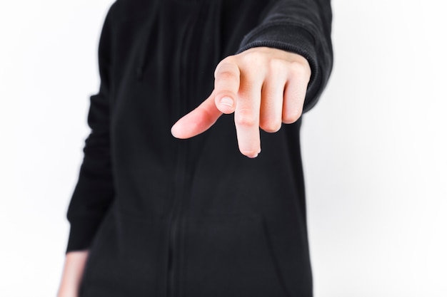 Midsection view of a human pointing finger Free Photo