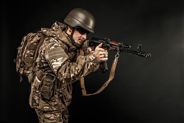Military male in uniform aiming with gun Premium Photo
