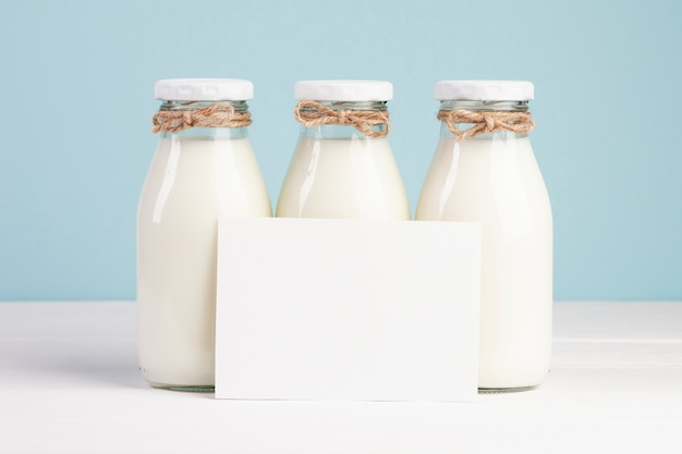 Milk bottles and copy space card Free Photo