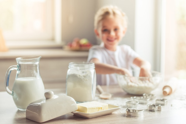 Milk, butter and flour for baking on the table. Premium Photo