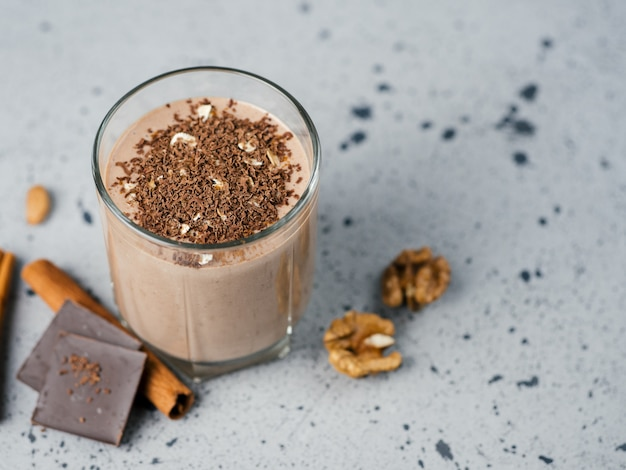 Milk chocolate smoothie with cocoa nuts cinnamon Premium Photo