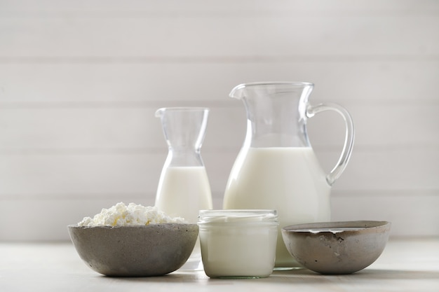 Milk products on wooden table Free Photo