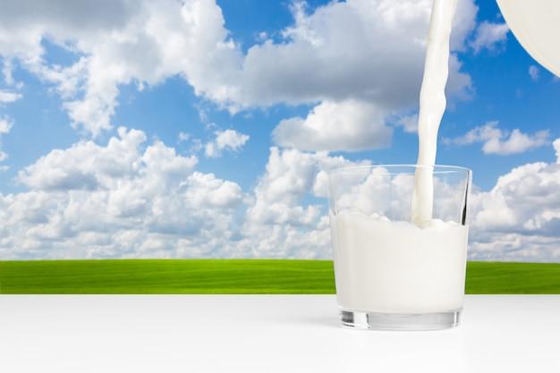 Milk on a table on blue sky Premium Photo