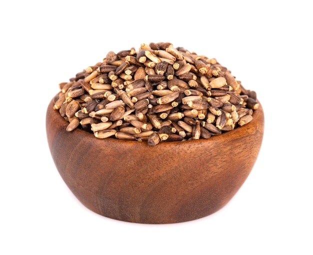 Milk thistle seed in wooden bowl, isolated on white background. silybum marianum, scotch thistle or marian thistle. Premium Photo