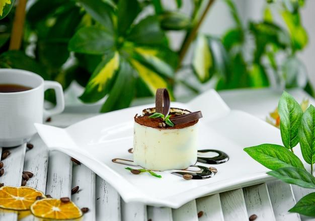Milk tiramisu with chocolade on the table Free Photo