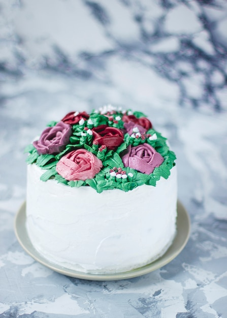 Milky girl cake slice decorated green leaves and lily flowers, cake decorated as flower bouquet, spring cake decor Free Photo