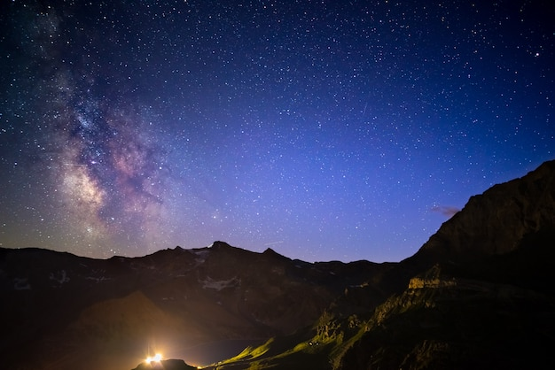 Milky way arch and the starry sky captured at high altitude in summertime on the italian alps, torino province. Premium Photo