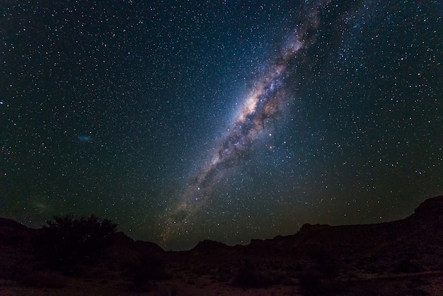 Milky way arch, stars in the sky, the namib desert in namibia, africa. the small magellanic cloud on the left hand side. Premium Photo