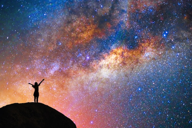 Milky way, star, with happy girl on the mountain Premium Photo