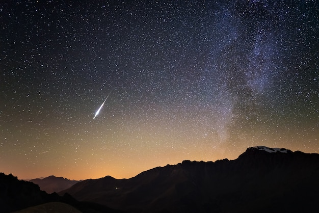 Milky way and starry sky from high up on the alps. real christmas comet in the sky. Premium Photo