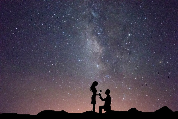 Milky way with silhouette of people Premium Photo
