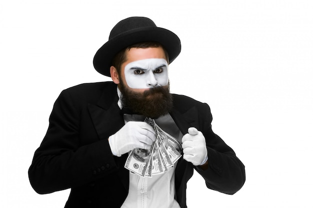 Mime as businessman putting money in his pocket Free Photo