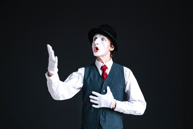 Mime in black sings a song Free Photo