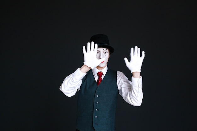 Mime holds his hands on invisible glass Free Photo